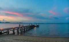 Sunset over the Andaman Sea (Merrillie) Tags: holidays resort landscape sunset pier water coconutisland phangngabay sea phuket beach people wharf andamansea dusk twilight island travel waterscape kohmaphrao thevillagecoconutisland clouds thailand