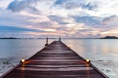 Sunrise over the Andaman Sea (Merrillie) Tags: holidays resort sunrise pier water coconutisland phangngabay clouds phuket beach andamansea wharf travel island kohmaphrao waterscape landscape thevillagecoconutisland sea thailand perspective