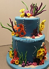 Under the sea kids birthday cake with edible sand, coral, tropical fish and sea grass. The mom put Nemo and Dory toys on at the party. #cake #greenvillesc #nemo #birthday #dory #cakedecorating #iongreenville #kids #bakery #customcakes #food http://www.art (arteatsbakery) Tags: customcakes greenvillesc dory food cake bakery iongreenville birthday nemo kids cakedecorating