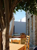 chora (athinaf) Tags: life light summer holiday tree tourism umbrella landscape lunch islands scenery mediterranean cross natural chairs religion aegean greece tables volcanic cycladic phenomena stonehouse