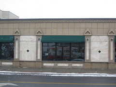empty storefront in Eastwood, Syracuse (by: Doug Kerr, creative commons license)