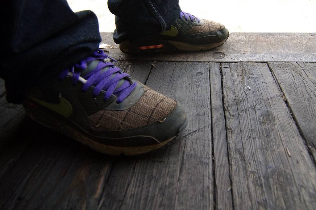 Fresh Nikes standing on a wooden boxcar floor