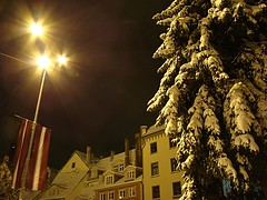 In Livu Square (Melnaapantera) Tags: winter snow lamp architecture night europe flag latvia fir lantern riga lettland latvija lettonie oldriga lvulaukums livusquare