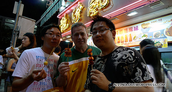 Ming Choy, Peter and I sharing skewer sticks on the street