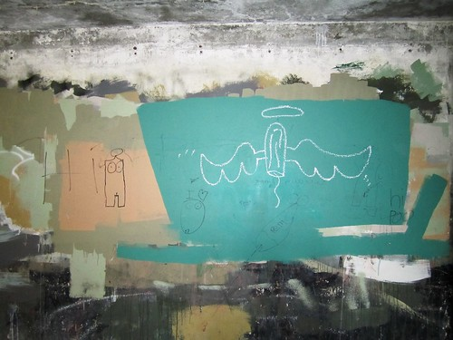 graffiti -- tampon with angel wings and a halo