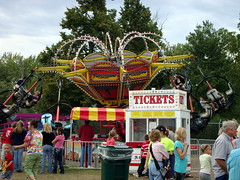 A&P Shows Ticket Box And Tornado Ride, Central Wisconsin State Fair. (dccradio) Tags: carnival trees motion festival wisconsin fun tickets amusement ride action fair entertainment ap rides wisdom midway countyfair tornado wi amusements ticketbooth coupons carnivalrides marshfield amusementride woodcounty ticketwindow ticketbox cwsf carnivalmidway centralwisconsin centralwisconsinstatefair ridetickets apshows apenterpriseshows apcarnival wisdomrides wisdomindustries apenterprises ridecoupons wisdommanufacturing