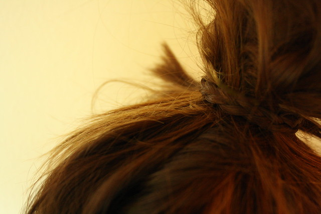 messy bun with braid.