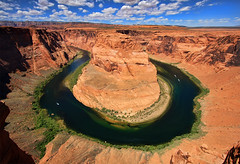 Looking Down on Horseshoe Bend (Dave Toussaint (www.photographersnature.com)) Tags: travel vacation arizona sky usa color nature water vertical clouds canon river landscape photo colorful skies photographer desert picture drop page coloradoriver northernarizona redrock 2010 10mm horseshoebend 40d photographersnaturecom davetoussaint kingbend 1000cliff gerology