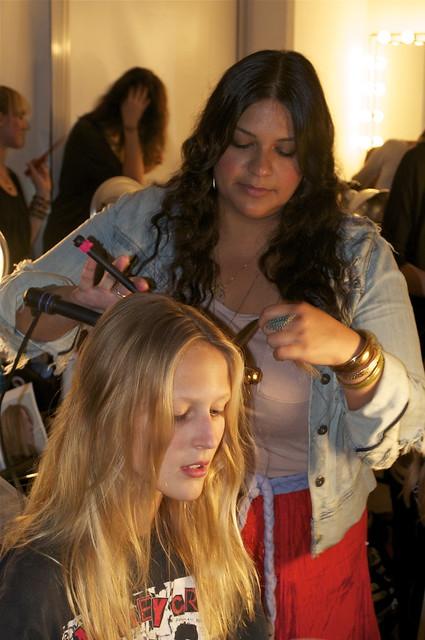 Amy Farid styles hair