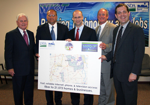 Federal, state and local officials display a map that highlights the coverage areas in which expanded and improved broadband service will be offered. They include (from left) Tom Fern, State Director for Rural Development (Ky.), Trevor Bonnstetter, CEO of WK&T, RUS Administrator Jonathan Adelstein, Bobby Goode, State Director for Rural Development (Tenn.), and Jonathan Miller, Ky. Finance Cabinet Secretary.