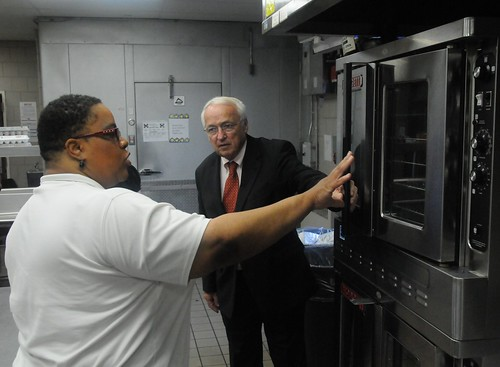 Jerrisa Carter shows Under Secretary Kevin Concannon new equipment purchased with ARRA funds.