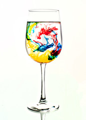Swirl (217 of 365) (lighthack) Tags: blue red water glass colors yellow nikon wine vivid highkey swirl marble liquid d700