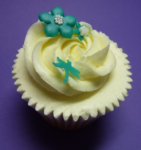 Vanilla cupcake with teal flowers-close up