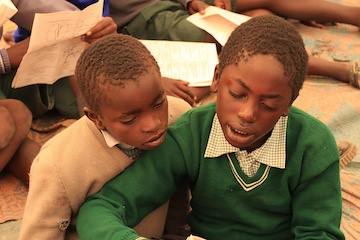 Learning together in a tent, Kids in Solio Settlement, Village 2, Central Kenya, before the Moving Mountains School opened Sept 2010.