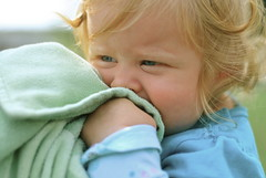 (maddie.brown) Tags: blue baby brown cute shirt wisconsin snuggle maddie eyes focus child adorable curls madison blond blanket blonde cuddle barbeque erfert