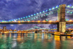 Brooklyn Bridge Night HDR (Mister Joe) Tags: newyorkcity bridge urban ny newyork skyline night reflections lights skyscrapers joe brooklynbridge eastriver nyny dynamicrange hdr