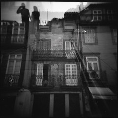(...storrao...) Tags: houses blackandwhite bw 6x6 film portugal mediumformat holga pessoas couple exposure fuji doubleexposure centro pb double porto rails neopan analogue filme casas pretoebranco carris 120mm analógico holgagraphy selfdeveloped onfilm fujineopan ilfordilfotechc film:iso=400 film:brand=fuji epsonv500scanner neopan400pro storrao sofiatorrão developer:brand=ilford film:name=fujineopan400 developer:name=ilfordilfotechc filmdev:recipe=6034