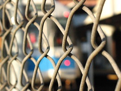reddot [wonderland] (gwennie2006) Tags: blue blur public car station train fence subway t ma dc aperture focus dof open blueline massachusetts line depthoffield chain chainlink transit link mbta mass wonderland trolly revere fstop reverema 02151 wonderlandstation dcmemorialfoundation pavillion1 4cheyenne pictures1b