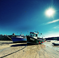 Mad dogs and Englishmen. High noon at St Ives harbour. (s0ulsurfing) Tags: pictures ocean uk blue light sea england sky sunlight lighthouse english water sunshine weather composition canon boats outdoors photography coast boat sand scenery cornwall day skies bright harbour britain pov vibrant ripple gull acid perspective shoreline picture sigma wideangle september chain coastal photograph shore 7d flare vista sunburst coastline british ripples rays colourful nautical fishingboat 1020 stives bouys 2010 tranquilscene leadinglines westcornwall beautyinnature buoyant s0ulsurfing vertorama ss21 canon7d welcomeuk