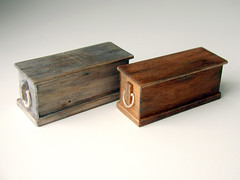 gray and brown sea chests