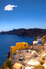 Only one cloud in Oia today - Greece (kryyslee) Tags: travel blue roof sea color church colors canon island photography eos photo foto photos couleurs picture ile roofs bleu santorini greece christophe toit backpacker santorin grce couleur oia fira toits bleus 50d kryyslee christophepaquignon paquignon