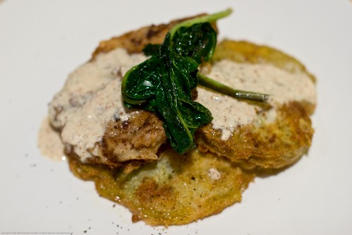 Chicken fried pork and fried green tomatoes, garden spinach