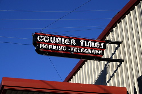 courier times neon sign