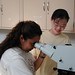 Students Using Microscope in Biology Lab