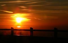Sunset Rail (FezLens) Tags: light sunset red sky orange sun tree nature colors silhouette clouds fence dawn sundown natural bright montreal horizon shapes rail sunny edge setting stjosephoratorio