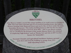 Photo of John Weaver white plaque