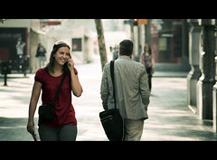 Strangers (Miniseries) (yeryi) Tags: barcelona street portrait woman smile calle nikon phone pareja bokeh retrato telephone bcn strangers movil sigma mobil stranger sonrisa 105 nikkor telefono 105mm d90 strangersinbarcelona