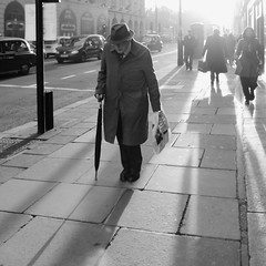 A trip into town (Ian Brumpton) Tags: blackandwhite bw blancoynegro umbrella square blackwhite noiretblanc streetphotography londres citystreets gentleman londonstreetphotography lifeinslowmotion autumntales scattidistrada ianbrumpton aimlessstrolling londonatlarge