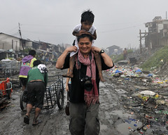 The long and treacherous road of humanitarian work (DirtyTrick) Tags: poverty boy bw dedication children philippines social manila environment adults humanitarian reportage tondo ulingan
