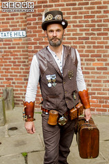 IMG_9333.jpg (Neil Keogh Photography) Tags: waistcoat goggles steampunk wgw shirt gold brown whitbygothicweekend goth man whitbygothicweekendapril2017 tophat feathers whitb white leather gloves black gothic male leatherwaistcoat medals cogs
