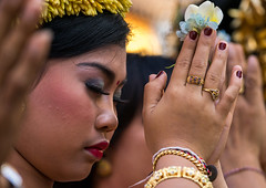 A teenage girl in traditional costume praying before a tooth filing ceremony, Bali island, Canggu, Indonesia (Eric Lafforgue) Tags: asia asian bali bali2363 balinese beliefs canggu ceremony closeup clothing colorimage customs filing headshot hindu hinduism horizontal indigenouspeople indonesia indonesian indonesianculture mesangih oneperson onewomanonly outdoors praying realpeople religion rite rites ritual sideview spiritual toothfiling tradition traveldestination women baliisland