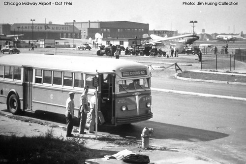 Historic Photo!  Northbound Chicago Surface Lines Company 1940's era White transit bus picking up passengers on South Cicero Avenue and West 61st Street across from Chicago's Midway Airport. Chicago Illinois. October 1946. by Eddie from Chicago