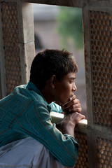 Observation post 2 (thedarkfrench) Tags: street travel pakistan boy portrait people children observation photography child eid 2009 lahore sebastien pascual mashrabiya subcontinent moucharabieh moucharabier thedarkfrench sebastienpascual