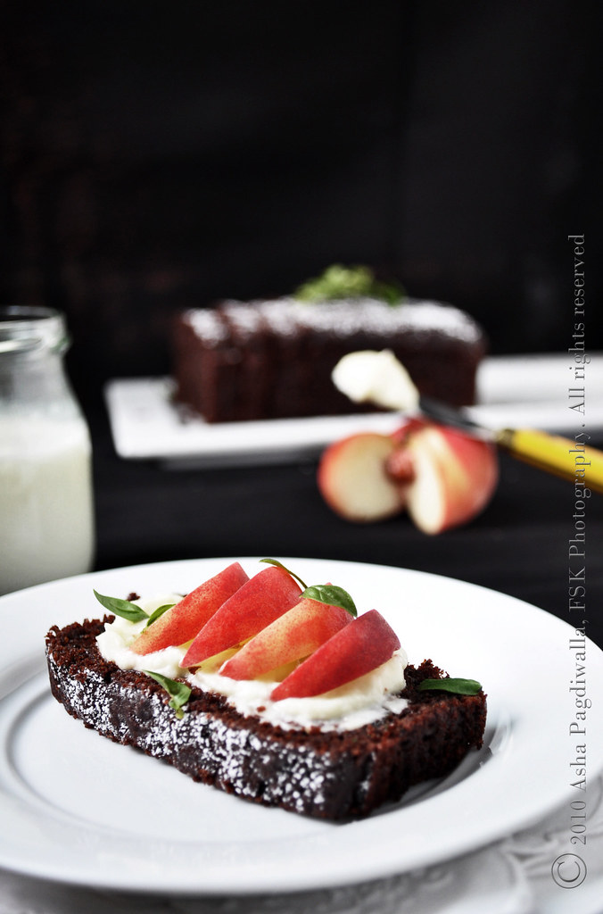 Chocolate loaf with mascarpone, peaches and basil close