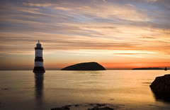 penmon dawn (i.m.j.) Tags: sea sun lighthouse water yellow wales sunrise island dawn coast cymru wideangle explore variation blackpoint anglesey ynysmn penmon arfordir gwawr tirlunlandscape saintseiriol efs1022mm13545usm anglesonian