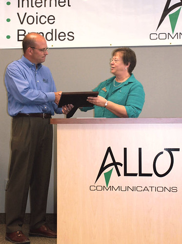 State Director Maxine Moul presents plaque to the President of Allo, Brad Moline for the Recovery Act funds Allo Communications secured to improve telecommunications services in part of Nebraska.