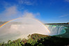 Rainbow over the Falls (askinimages) Tags: sky nature beauty clouds niagarafalls landscapes skies places rainbows naturalbeauty rushing rushingwater niagarariver wondersoftheworld wideanglephotography
