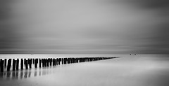 Groynes-V (DolliaSH) Tags: longexposure sea blackandwhite bw seascape holland blanco beach strand canon topf50 europe zwartwit negro nederland thenetherlands playa zeeland filter le topf100 plage spiaggia ranta zuidholland 1755 domburg zeewering southholland zwartenwit 50d canonefs1755mmf28isusm nd110 canoneos50d dollia dollias sheombar plyazh dolliash bw10stopsolidndfilter