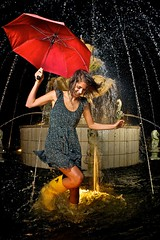 Splash! (dmdzine) Tags: portrait woman color water fountain girl umbrella fun hope boots retro splash regent redumbrella d90 yellowboots strobist afsnikkor1735mmf28difed