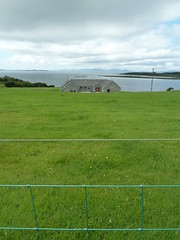 A Cottage Overlooking The West Loch Tarbert (Dunnock_D) Tags: cottage west loch tarbert grass field garden fence sea islands clouds cloud cloudy sky britain argyll kintyre unitedkingdom uk scotland gb