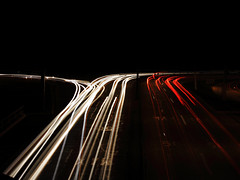 Long trails (Gerardography) Tags: light red white cars colors car night contrast canon photography is long exposure trails 55mm 18mm 500d t1i