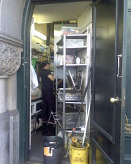 Kitchen wedged in (TenguTech) Tags: kitchen person cafe sydney australia nsw cbd qvb 2010 queenvictoriabuilding