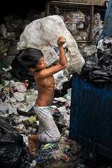 Aroma, Housing Estate, Tondo - Where the garbage worth a fortune (Mio Cade) Tags: poverty boy truck bag compound kid garbage child estate philippines dirty rubbish manila housing smelly scavenger ultraman reportage aroma