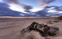 hitherto (gobayode photography...times) Tags: wood uk england seascape nature liverpool landscapes seaside twilight stones sunsets treetrunk journey trunk sanddunes crosby beachsand crosbybeach northwestengland seajourney beachattwilight naturecolours beachscapes crosbymerseyside natureelements beachsanddunes merseysidebeaches