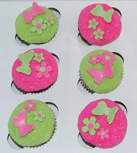 bright pink and green glitter cupcakes with butterflies