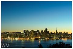 Never sleeps (W Mustafeez) Tags: sanfrancisco longexposure sunset sky building bay nikon long exposure cityscape treasureisland dusk tripod citylights bayarea transamerica d700